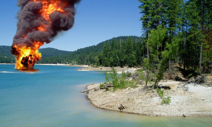 This photo was taken seconds after the explosion on Scotts Flat Lake. The Family was carted away by State and Federal officials.