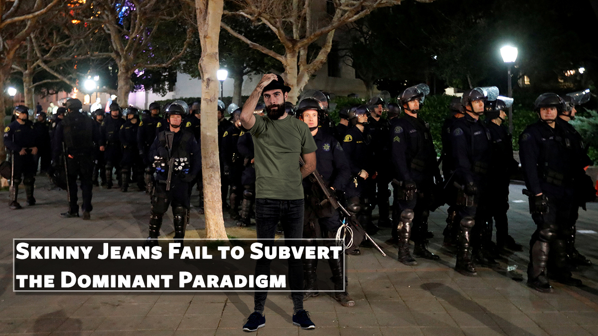"""Self-proclaimed postmodern social justice warrior David """"Riddle Me"""" Shoreston seen here trying to disrupt fascist police officers with his trademark skinny jeans and fedora."""